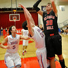 OBA's Adam Eaton shoots over Chisholm's Danner Kiernan Tuesday at Chisholm High School. (Staff Photo by BILLY HEFTON)