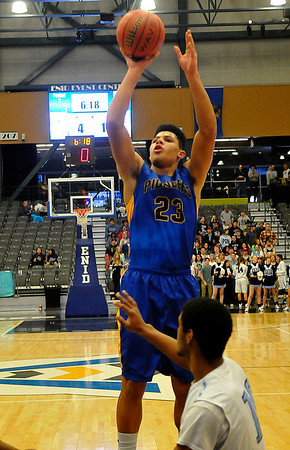 Jordan Brown puts up a shot against Enid Tuesday at the Enid Event Center. Enid News & Eagle Photo by Billy Hefton)