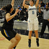 Enid's Haven Bay shoots over Stillwater's LEricka Stevenson Tuesday at the Enid Event Center. (Staff Photo by BILLY HEFTON)
