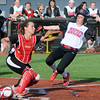 NOC Enid's Bailey King beats the tag and scores for the Lady Jets at David Allen Memorial Ballpark Friday, Feb. 28, 2014. (Staff Photo by BONNIE VCULEK)