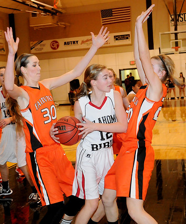 Fairview's Sadie Mason (left) and Abby Smith (right) pressure OBA's Savannah Price during the Lady Jackets 63-34 win over the Lady Trojans at Oklahoma Bible Academy Friday, Feb. 7, 2014. (Staff Photo by BONNIE VCULEK)
