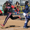 Avery Walker scores the Lady Jets' first run behind Frank Phillips' Erica Chasco during the Lady Jets' inaugural game at Pacer Field Friday, Feb. 14, 2014. (Staff Photo by BONNIE VCULEK)