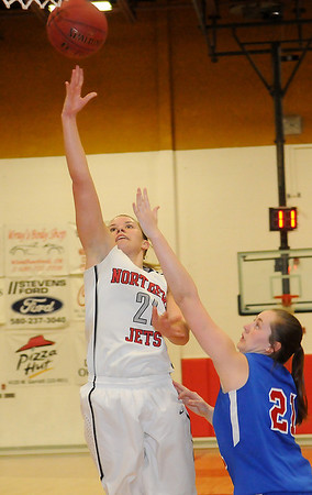 NOC-Enid Lady Jets' Rylie Swanson scores against Murray State Saturday, Feb. 15, 2014. (Staff Photo by BONNIE VCULEK)