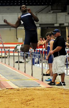 Enid's Marshawn Mills competes in the long jump during the Oklahoma Track Coaches Association Indoor Championships at the Chisholm Trail Expo Center Friday, Feb. 14, 2014. (Staff Photo by BONNIE VCULEK)