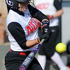 NOC Enid's Aaliyah Sebock connects with a pitch at David Allen Memorial Ballpark Friday, Feb. 28, 2014. (Staff Photo by BONNIE VCULEK)