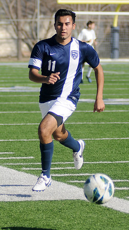 Felix Mora controls the ball during the Enid Plainsmen's game against the Enid Alumni at D. Bruce Selby Stadium Saturday, Feb. 22, 2014. (Staff Photo by BONNIE VCULEK)