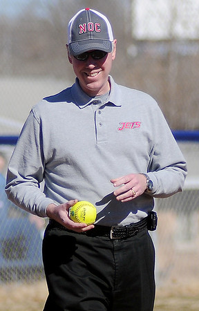 Dr. Ed Vineyard prepares for the ceremonial first pitch before the inaugural NOC-Enid Lady Jets game at Pacers' Field Friday, Feb. 14, 2014. (Staff Photo by BONNIE VCULEK)