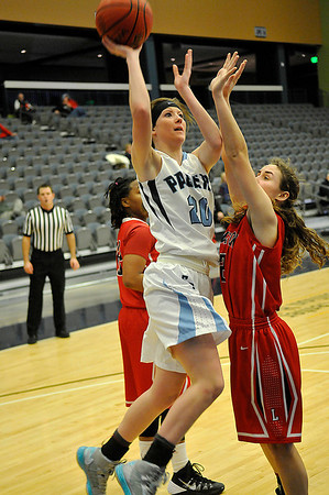 Enid's Andi Pierce shoots over Lawton's Caitlyn Cox Monday at the Enid Event Center. (Staff Photo by BILLY HEFTON)