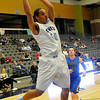 Enid's Devon Edwards grabs a rebound against Stillwater Tuesday at the Enid Event Center. (Staff Photo by BILLY HEFTON)