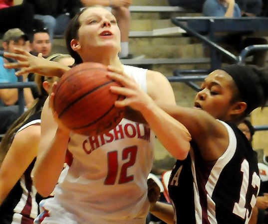 Chisholm's Kaylee Petersen drives the lane for two and one against a Watonga player Friday, Feb. 14, 2014. (Staff photo by BONNIE VCULEK)