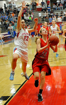 Chisholm's Kammi Gruber runs down OBA's Erin Coffin to block her shot Tuesday at Chisholm High School. (Staff Photo by BILLY HEFTON)