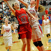 Chisholm's Nicole Middleton blocks the shot of OBA's Erin Coffin Tuesday at Chisholm High School. (Staff Photo by BILLY HEFTON)