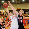 Chisholm's Kaci McCary drives inside and scores against Watonga Friday, Feb. 14, 2014. (Staff Photo by BONNIE VCULEK)