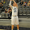 Enid's Braden Rogers shoots Bishop McGuinness Tuesday at the Enid Event Center. (Staff Photo by BILLY HEFTON)