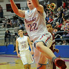 Chisholm's Luke Ball scores for the Longhorns against Watonga Friday, Feb. 14, 2014. (Staff Photo by BONNIE VCULEK)