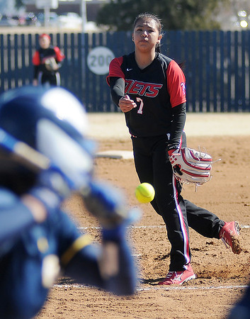 NOC-Enid Lady Jets' Summer Leitka hurls a strike to a Frank Phillips player during the Lady Jets' inaugural softball game at Pacer Field Friday, Feb. 14, 2014. (Staff Photo by BONNIE VCULEK)