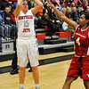 NOC Enid's Kori Barrios puts up a shot in the lane against NOC Tonkawa's Danielle Carr Monday at the Mabee Center. (Staff Photo by BILLY HEFTON)