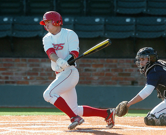 NOC Enid's Matt Foster drives in a run against Brown Mackie Tuesday at David Allen Memorial Ballpark. (Staff Photo by BILLY HEFTON)