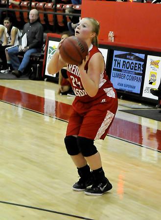 Kremlin-Hillsdale's Katie Davis sets to shoot against Pond Creek-Hunter during a regional playoff game February 19, 2015. (Staff Photo by BILLY HEFTON)