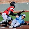 The ball bounces away from NOC Enid catcher, Case Harper, as Justin Lott of SE Nebraska CC  slides into home Saturday February 13, 2016 at David Allen Memorial Ballpark. (Billy Hefton / Enid News & Eagle)