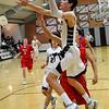 Garber's Parker Betchan drives to the basket against DCLA Tuesday February 9, 2016 at Garber High School. (Billy Hefton / Enid News & Eagle)