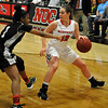NOC Enid's Carley Frymire looks for an opening against Western's Mischelle Jones Thursday February 18, 2016 at the NOC Mabee Center. (Billy Hefton / Enid News & Eagle)