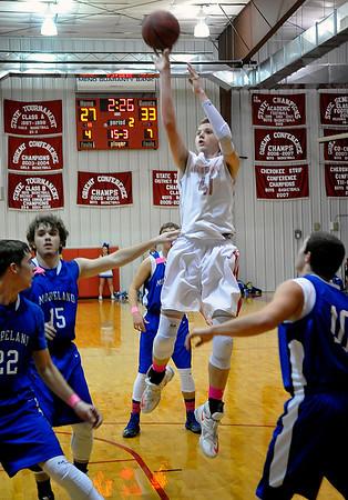 Ringwood's Camden Patterson shoots against Mooreland Friday February 5, 2016 at Ringwood High School. (Billy Hefton / Enid News & Eagle)