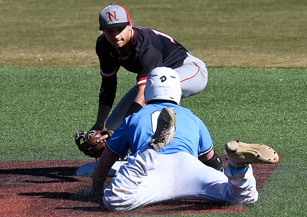 NOC Enid's T.J. Black tags out SE Nebraska's Masen Prososki at second base Saturday February 11, 2017 at David Allen Ballpark. (Billy Hefton / Enid News & Eagle)