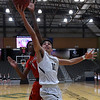 Enid's Orion Tafoya goes to the basket against Lawton's Mark Berry Friday February 3, 2017 at the Central National bank Center. (Billy Hefton / Enid News & Eagle)