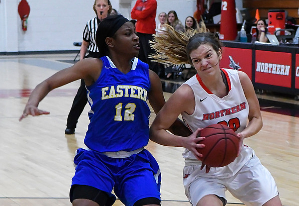 NOC Enid's McKenna Pulley drives to the basket against Eastern's Taylor Tennison Thursday February 16, 2017 at the NOC Mabee Center. (Billy Hefton / Enid News & Eagle)