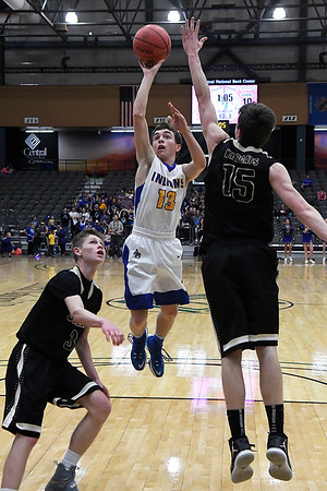 Arapaho-Butler's Tucker Powell gets off a shot in the lane against Seiling's Michael Cansler and Brevin Nyberg during the consolation finals of the class A area playoff tournament at the Central National Bank Center Saturday February 25, 2017. (Billy Hefton / Enid News & Eagle)