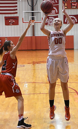 Ringwood's Hannah Maples shoots over Cherokee's Lizzy Webster Friday February 10, 2017 during the opening round of the district tournament at Ringwood High School. (Billy Hefton / Enid News & Eagle)
