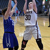 Garber's Madison Terry shoots over Baylee Felber of Waukomis during an elemination game in the class A area tournament Friday February 24, 2017 at the Central National Bank Center. (Billy Hefton / Enid News & Eagle)