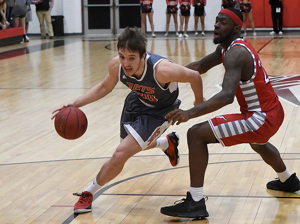 NOC Enid's Ty Lazenby drives the lane against NOC Tonkawa's Ralph Bellamy Thursday February 9, 2017 at the NOC Mabee Center. (Billy Hefton / Enid News & Eagle)