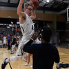 """Enid's Dylan Smith """"dunks"""" over Jerra Williams during player introductions on senior night Saturday February 11, 2017 at the Central National Bank Center. (Billy Hefton / Enid News & Eagle)"""