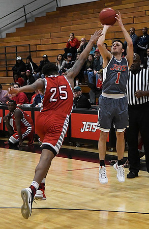 NOC Enid's Cade Upshaw shoot over NOC Tonkawa's Dwayne Brown, Jr. Thursday February 9, 2017 at the NOC Mabee Center. (Billy Hefton / Enid News & Eagle)