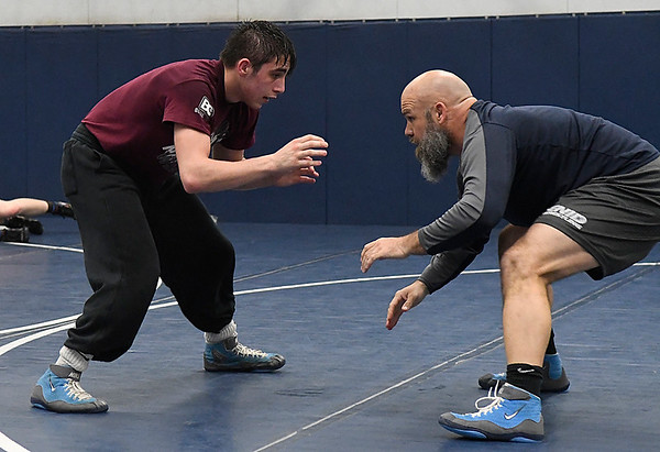 Austin Loza works out with coach, Trent Holland, while preparing for the state tournament. (Billy Hefton / Enid News & Eagle)