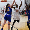 NOC Enid's Dossou Ndiaye puts up a shot against Northeastern Oklahoma's Sara Boric and Hatty Nawezhi Thursday February 23, 2017 at the NOC Mabee Center. (Billy Hefton / Enid News & Eagle)