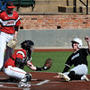 NOC Enid's Case Harper tags out SE Nebraska's Grant Von Scoy as Josh Rutland looks on during the opening game of the season Friday at David Allen Ballpark Friday February 10, 2017. (Billy Hefton / Enid News & Eagle)