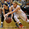 Ringwood's Abigail Anderson tries to steal the ball from Waukomis' Slater Eck Thursday February 2, 2016 at Ringwood HIgh School. (Billy Hefton / Enid News & Eagle)