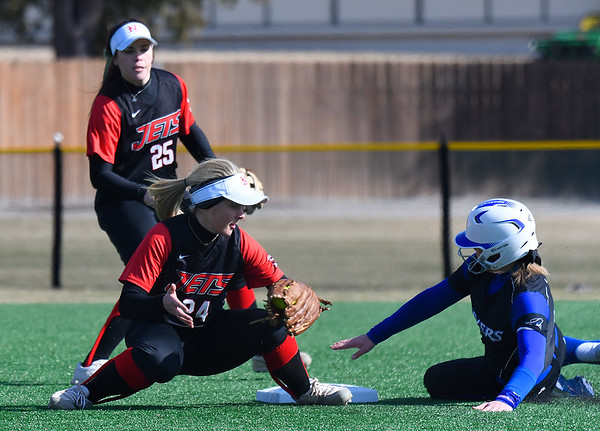NOC Enid's Kaitlyn Statk attempts to tag Iowa Western's Zoe Hicks at second base during the season opening game Friday February 3, 2017 at Failing Field. (Billy Hefton / Enid News & Eagle)