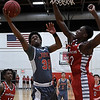 NOC Enid's Sebastain Gray puts up a shot against NOC Tonkawa's Reggie Scurry Thursday February 9, 2017 at the NOC Mabee Center. (Billy Hefton / Enid News & Eagle)