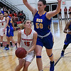NOC Enid's Lora Riley drives to the basket against Northeastern Oklahoma's Sara Boric Thursday February 23, 2017 at the NOC Mabee Center. (Billy Hefton / Enid News & Eagle)