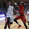 Enid's Jerra Williams goes to the basket against Lawton's Mark Berry Friday February 3, 2017 at the Central National bank Center. (Billy Hefton / Enid News & Eagle)