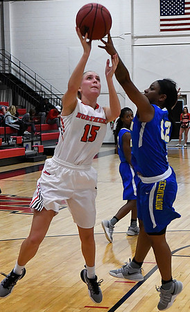 NOC Enid's Lora Riley puts up a shot against Eastern's Taylor Tennison Thursday February 16, 2017 at the NOC Mabee Center. (Billy Hefton / Enid News & Eagle)