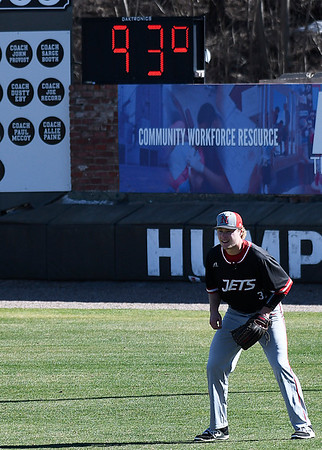 NOC Enid's Griffin Keller watches the pitch from right field as the temperature climbed to 93 degrees during a game against SE Nebraska Saturday Febrayry 11, 2017 at David Allen Ballpark. (Billy Hefton / Enid News & Eagle)