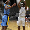 Enid's Jerra Williams shoots over Putnam City West's Gerren Jackson Tuesday February 14, 2017 at the Central National Bank Center. (Billy Hefton / Enid News & Eagle)