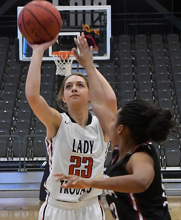 OBA's Peyton Watkins shoots over Watonga's Allie Baker Saturday February 4, 2017 during the Downtown Basketball Festival at the Central National Bank Center. (Billy Hefton / Enid News & Eagle)