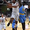 Enid's Will Phillips goes up and under against Putnam City West's Marquis Gatewood Tuesday February 14, 2017 at the Central National Bank Center. (Billy Hefton / Enid News & Eagle)