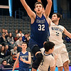 Hennessey's Dalton Vinson drives to the basket against Newkirk's Colby Case and Cameron Barnes Saturday February 4, 2017 during the Downtown Basketball Festival at the Central National Bank Center. (Billy Hefton / Enid News & Eagle)